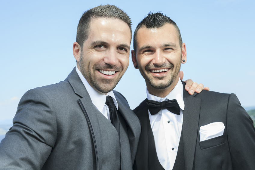 36946588-Portrait-of-a-loving-gay-male-couple-on-their-wedding-day--Stock-Photo