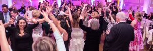 bride dancing in a crowd during her reception