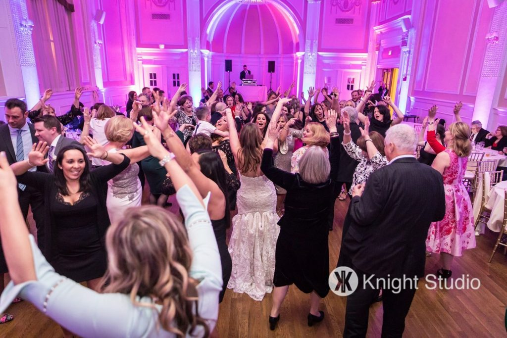 bride dancing in the middle of a crowd during reception