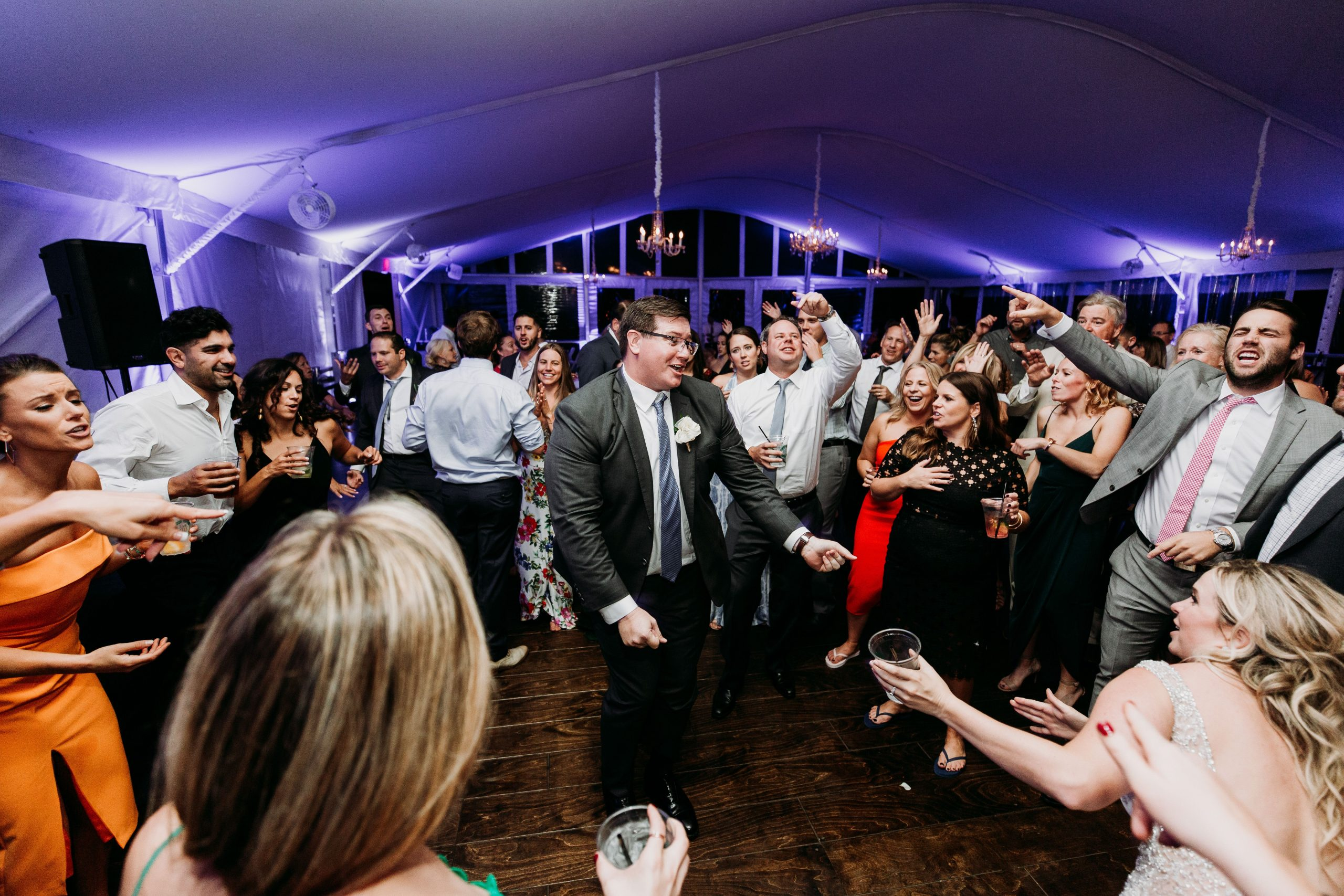 groom in the middle of a circle of people dancing
